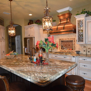 Mid-sized traditional eat-in kitchen pictures - Mid-sized elegant u-shaped medium tone wood floor eat-in kitchen photo in Tampa with an undermount sink, raised-panel cabinets, distressed cabinets, granite countertops, red backsplash, stone tile backsplash, stainless steel appliances and an island