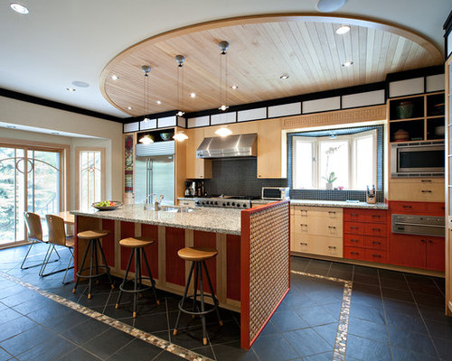 Trendy Galley Kitchen Photo In Toronto With Red Cabinets, Flat Panel  Cabinets, Mosaic