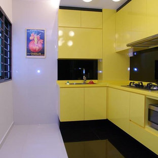 Photo of a modern l-shaped separate kitchen in Singapore with a drop-in sink, marble floors and no island.