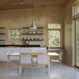 Esempio di una cucina abitabile minimalista con elettrodomestici bianchi e nessun'anta