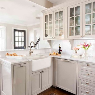 Small traditional enclosed kitchen inspiration - Example of a small classic medium tone wood floor enclosed kitchen design in Atlanta with glass-front cabinets, subway tile backsplash, a farmhouse sink, gray cabinets, marble countertops, white backsplash, paneled appliances and no island