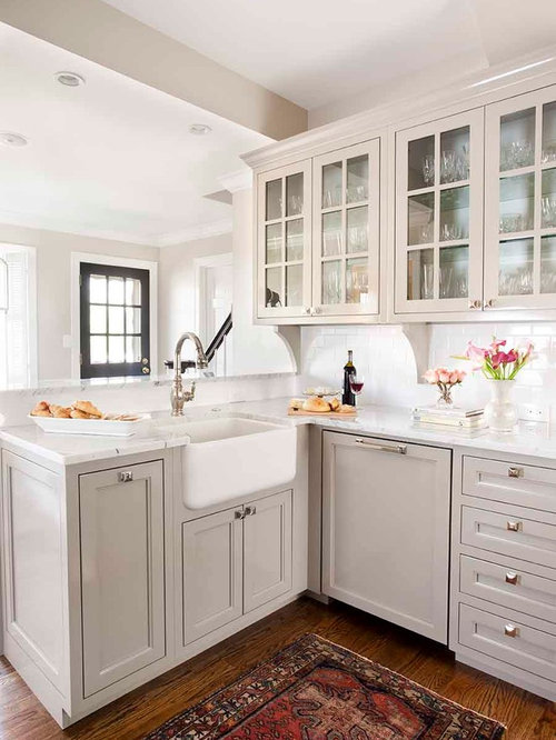Small traditional enclosed kitchen inspiration - Example of a small classic  medium tone wood floor enclosed