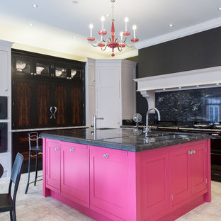 Inspiration for a mid-sized contemporary u-shaped eat-in kitchen in Cheshire with a drop-in sink, shaker cabinets, white cabinets, granite benchtops, black splashback, marble splashback, black appliances, ceramic floors, with island and beige floor.