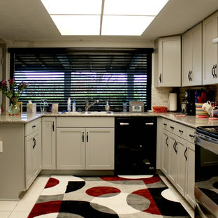 This is an example of a small transitional u-shaped open plan kitchen in Dallas with a double-bowl sink, shaker cabinets, grey cabinets, granite benchtops, multi-coloured splashback, glass sheet splashback, stainless steel appliances, ceramic floors, a peninsula and pink floor.