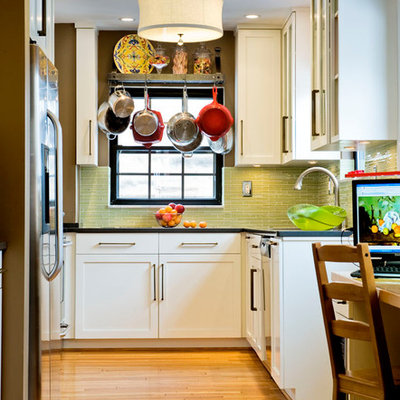 Eclectic u-shaped enclosed kitchen photo in Other with green backsplash, white cabinets, shaker cabinets, glass tile backsplash and stainless steel appliances