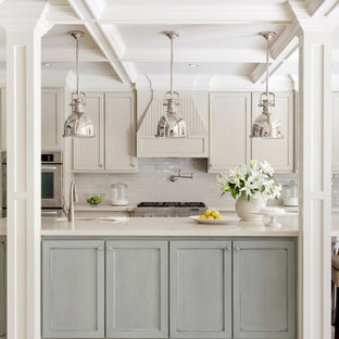 Mid-sized transitional kitchen pictures - Mid-sized transitional kitchen photo in Little Rock with stainless steel appliances, subway tile backsplash, recessed-panel cabinets, blue cabinets, white backsplash, an undermount sink, quartz countertops and an island
