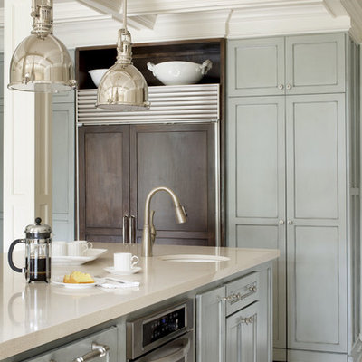 Mid-sized transitional u-shaped kitchen photo in Little Rock with stainless steel appliances, an undermount sink, recessed-panel cabinets, blue cabinets, quartz countertops, white backsplash, subway tile backsplash and an island