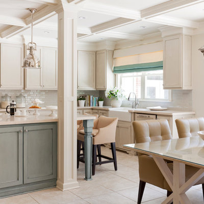 Example of a mid-sized transitional u-shaped eat-in kitchen design in Little Rock with subway tile backsplash, a farmhouse sink, recessed-panel cabinets, quartz countertops, white backsplash, paneled appliances, an island and beige cabinets