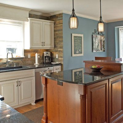 Inspiration for a timeless eat-in kitchen remodel in Detroit with a single-bowl sink, raised-panel cabinets, white cabinets, gray backsplash, stainless steel appliances and slate backsplash