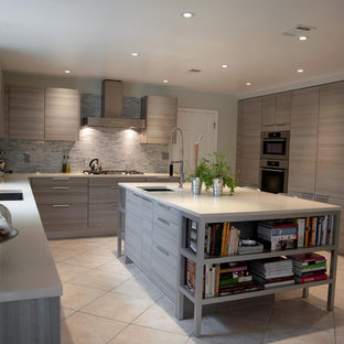 Example of a trendy kitchen design in Other with paneled appliances