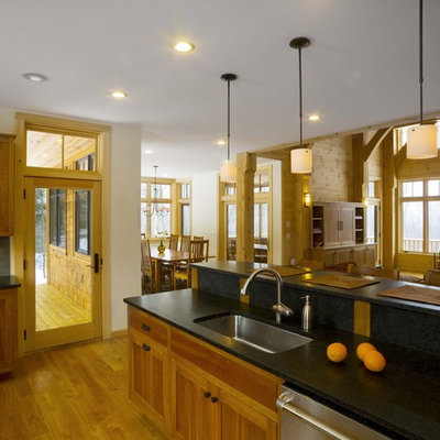 Open concept kitchen - large rustic u-shaped open concept kitchen idea in Burlington with an undermount sink, an island, recessed-panel cabinets, medium tone wood cabinets, gray backsplash and stainless steel appliances
