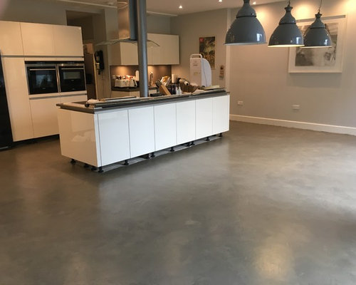 polished concrete floor in bronze colour over existing floor tiles london