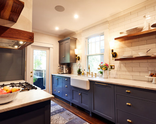 Small Traditional Enclosed Kitchen Pictures   Small Elegant Galley Medium  Tone Wood Floor Enclosed Kitchen Photo