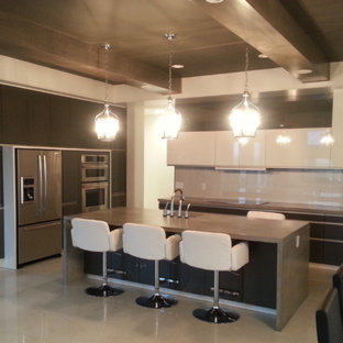 Modern eat-in kitchen ideas - Inspiration for a modern galley eat-in kitchen remodel in Edmonton with an undermount sink, flat-panel cabinets, gray cabinets, concrete countertops, white backsplash, glass sheet backsplash and stainless steel appliances