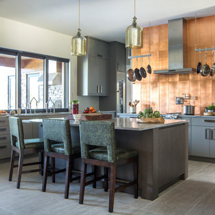 Large contemporary eat-in kitchen ideas - Large trendy l-shaped porcelain tile and gray floor eat-in kitchen photo in Jacksonville with flat-panel cabinets, gray cabinets, marble countertops, metallic backsplash, stainless steel appliances, an island, gray countertops and metal backsplash