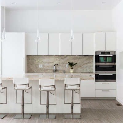 Trendy light wood floor kitchen photo in Boston with flat-panel cabinets, white cabinets, an island and marble backsplash