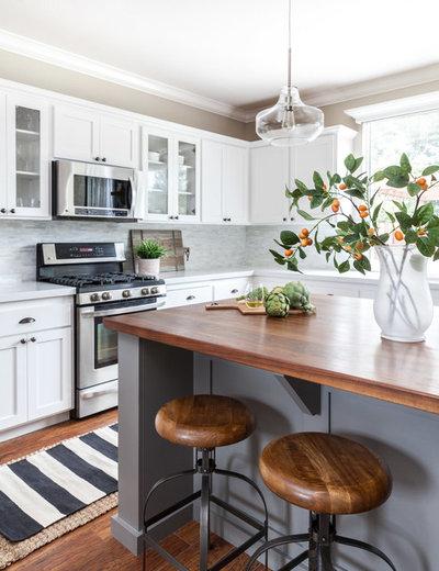 Farmhouse Kitchen by Juxtaposed Interiors