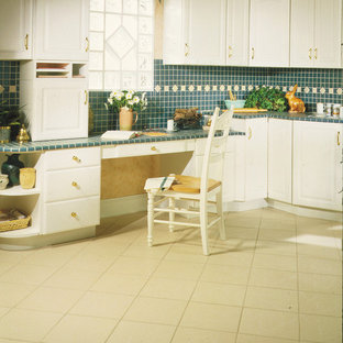 Inspiration for a traditional kitchen in Seattle with raised-panel cabinets, white cabinets, tile benchtops, green splashback, mosaic tile splashback and porcelain floors.