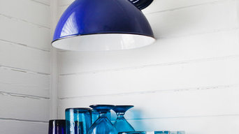 Porcelain Wall Sconce Illuminates Open Shelving in Kitchen Design