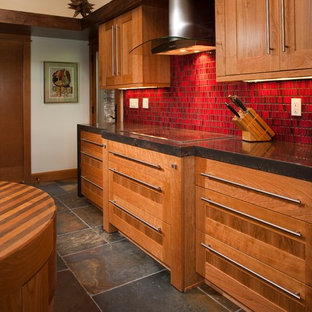 Large contemporary eat-in kitchen inspiration - Example of a large trendy u-shaped ceramic floor eat-in kitchen design in Seattle with an undermount sink, medium tone wood cabinets, onyx countertops, red backsplash, ceramic backsplash, stainless steel appliances and an island