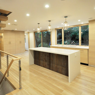 Design ideas for a mid-sized modern l-shaped eat-in kitchen in New York with an undermount sink, flat-panel cabinets, medium wood cabinets, quartzite benchtops, green splashback, glass tile splashback, stainless steel appliances, porcelain floors, with island and beige floor.
