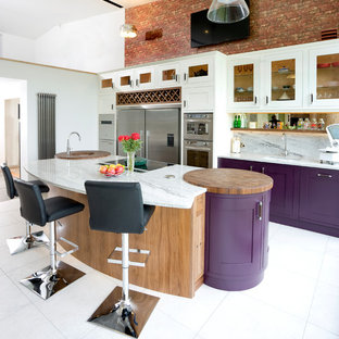 Design ideas for a medium sized contemporary kitchen in Other with a submerged sink, shaker cabinets, white cabinets, marble worktops, grey splashback, stone slab splashback, stainless steel appliances and an island.