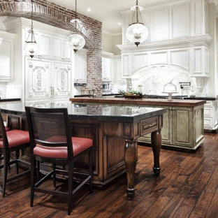 Inspiration for a large galley eat-in kitchen in Dallas with beaded inset cabinets, white cabinets, onyx benchtops, multiple islands and green benchtop.
