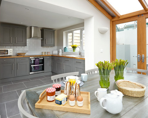 Example Of A Coastal Gray Floor Eat In Kitchen Design In Sussex With A Drop