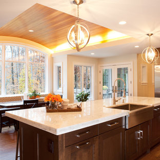 Inspiration for a transitional kitchen remodel in DC Metro with stainless steel appliances, a farmhouse sink and quartzite countertops