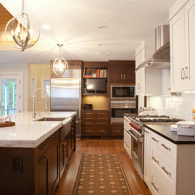 Transitional kitchen photo in DC Metro with stainless steel appliances and a farmhouse sink