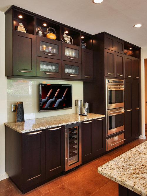 kitchen with yellow backsplash and dark wood cabinets design ideas