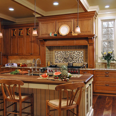 Eat-in kitchen - mid-sized traditional single-wall medium tone wood floor eat-in kitchen idea in DC Metro with an undermount sink, beaded inset cabinets, medium tone wood cabinets, granite countertops, multicolored backsplash, stainless steel appliances, an island and ceramic backsplash
