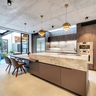 Photo of a large contemporary galley eat-in kitchen in Sydney with an undermount sink, flat-panel cabinets, medium wood cabinets, marble benchtops, grey splashback, stone slab splashback, stainless steel appliances, ceramic floors, with island, grey floor and grey benchtop.