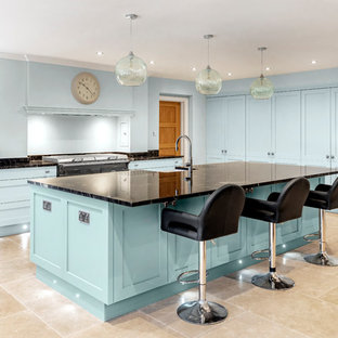 Traditional kitchen in Other with a belfast sink, shaker cabinets, blue cabinets, blue splashback, an island, beige floors, black worktops and granite worktops.