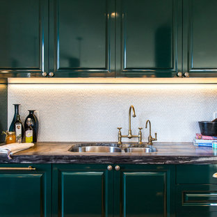 Transitional kitchen in Vancouver with a double-bowl sink, raised-panel cabinets, green cabinets and white splashback.