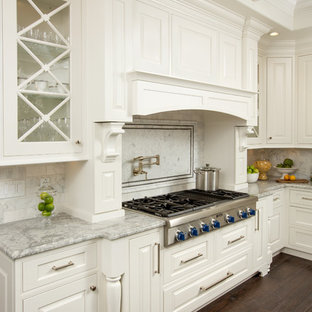 Huge traditional kitchen inspiration - Inspiration for a huge timeless u-shaped dark wood floor kitchen remodel in Columbus with a farmhouse sink, beaded inset cabinets, white cabinets, granite countertops, white backsplash, stone tile backsplash, paneled appliances and an island