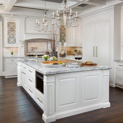 Inspiration for a huge timeless u-shaped dark wood floor kitchen remodel in Columbus with beaded inset cabinets, white cabinets, white backsplash, paneled appliances, an island, granite countertops and stone tile backsplash