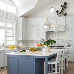 Beach style kitchen photos - Example of a coastal kitchen design in Other