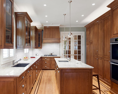 ... Kitchen Design Photos with Dark Wood Cabinets and an Undermount Sink
