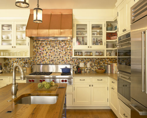 ... , multicolored backsplash, glass-front cabinets and white cabinets