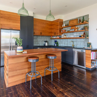 Mid-sized country l-shaped kitchen in Melbourne with a drop-in sink, flat-panel cabinets, brown cabinets, green splashback, stainless steel appliances, dark hardwood floors, multiple islands and brown floor.