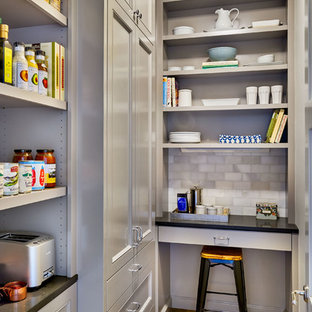 Mid-sized traditional kitchen pantry photos - Inspiration for a mid-sized timeless galley light wood floor kitchen pantry remodel in Portland with gray cabinets, recessed-panel cabinets, quartz countertops, gray backsplash, stone tile backsplash and no island