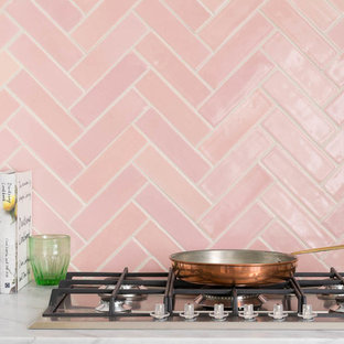 Eat-in kitchen inspiration - Inspiration for an eat-in kitchen remodel in Other with marble countertops, pink backsplash, ceramic backsplash and white countertops