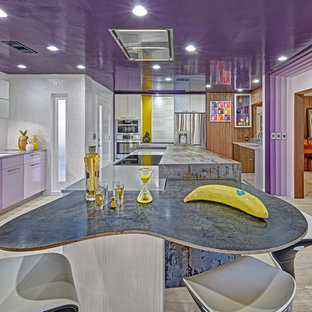 Inspiration for a large modern l-shaped separate kitchen in Sacramento with an undermount sink, flat-panel cabinets, purple cabinets, quartz benchtops, white splashback, porcelain splashback, stainless steel appliances, light hardwood floors and with island.