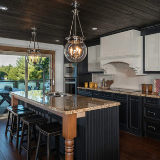 Inspiration for a mid-sized country single-wall eat-in kitchen in Toronto with an undermount sink, beaded inset cabinets, medium wood cabinets, granite benchtops, beige splashback, porcelain splashback, stainless steel appliances, medium hardwood floors and with island.