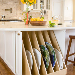 Traditional kitchen pictures - Example of a classic kitchen design in San Francisco with recessed-panel cabinets, white cabinets and beige backsplash