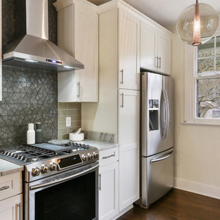 Small transitional eat-in kitchen designs - Example of a small transitional dark wood floor eat-in kitchen design in New Orleans with a farmhouse sink, shaker cabinets, white cabinets, marble countertops, green backsplash, glass tile backsplash, stainless steel appliances and no island