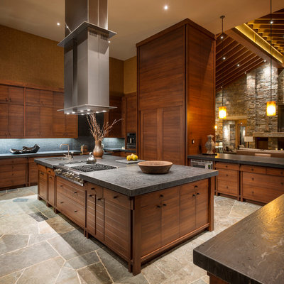 Example of a mountain style u-shaped open concept kitchen design in Seattle with flat-panel cabinets, medium tone wood cabinets, gray backsplash and slate backsplash