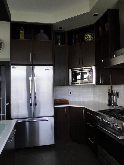 kitchen design photos with yellow splashback and dark wood cabinets