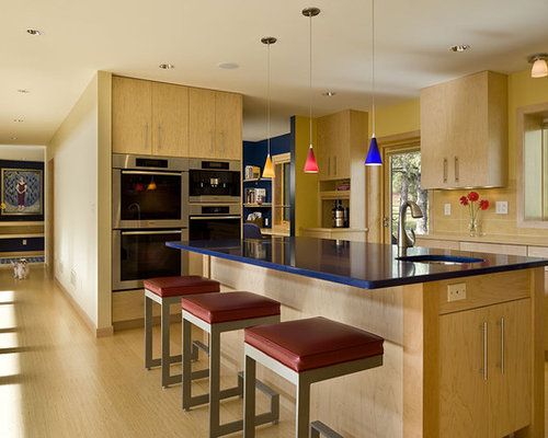Trendy Kitchen Photo In Minneapolis With Stainless Steel Appliances,  Flat Panel Cabinets And Light Part 5